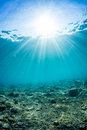 Rays of sunlight shining into sea, underwater view Royalty Free Stock Photo