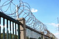 Razor wire is a curved variation of barbed Stock Photography