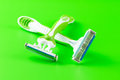 Razors close up of two shaving on green background Stock Photos