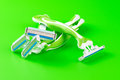 Razors close up of two shaving on green background Royalty Free Stock Images