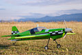 RC model green plane on runway Royalty Free Stock Photo