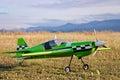 RC model green plane on runway Royalty Free Stock Photo