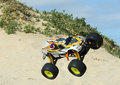Rc nitro monster truck action shots of a scale radio control powered on the beach and dunes Stock Image
