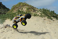 Rc nitro monster truck action shots of a scale radio control powered on the beach and dunes Royalty Free Stock Photos