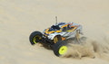 Rc nitro monster truck action shots of a scale radio control powered on the beach and dunes Stock Photo