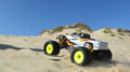 Rc nitro monster truck action shots of a scale radio control powered on the beach and dunes Royalty Free Stock Photography