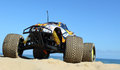 Rc nitro monster truck action shots of a scale radio control powered on the beach and dunes Stock Photos