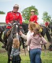 Rcmp meet and greet a child petting an horse at the chesterville musical ride Stock Images