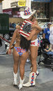 Re enactment of historic kiss in times square local tourist entertainers known as the naked cowboy and the naked cowgirl reenact Stock Photography