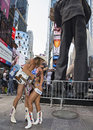 Re enactment of historic kiss in times square local tourist entertainers known as the naked cowboy and the naked cowgirl reenact Royalty Free Stock Photos