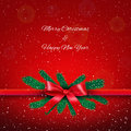 Re ribbon with bow over red starry christmas background Royalty Free Stock Photo