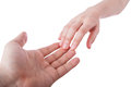 Reaching and touching hands. Royalty Free Stock Photo