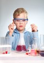 Reaction vertical shot of a school scientist being curious about chemical Royalty Free Stock Photography
