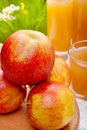 Read apples and juice glasses of Royalty Free Stock Photo
