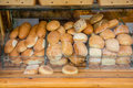 Read and buns on a showcase lots of bread facing the street Stock Photography