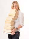 The reader young cute blond girl holding a pile of books Stock Image