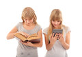 Readers two girl reading books traditonal and ebook ones Stock Photos
