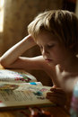 Reading abc book boy in the house Stock Photography