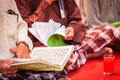 Reading arabic writings view of a person a book written in letters Stock Photos
