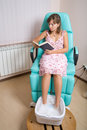 Reading at beauty salon Royalty Free Stock Image