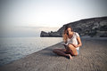 Reading a book at the beach Royalty Free Stock Photo