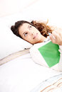 Reading a book in bed young latin woman Royalty Free Stock Photos