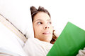 Reading a book in bed young latin woman Stock Photography