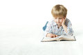 Kid Reading Book, Little Child Boy Read in School, lying down white floor Royalty Free Stock Photo