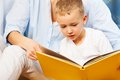 Reading a book with mothers help Royalty Free Stock Photo