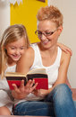 Reading book together mother and daughter old Stock Images