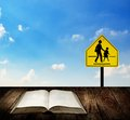 Reading book for understand traffic sign education safety concept Royalty Free Stock Photography