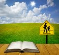 Reading book for understand traffic sign education safety concept Royalty Free Stock Images