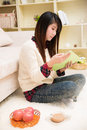 Reading book young asian woman at home Stock Photography