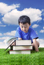 Reading books outdoor Royalty Free Stock Image