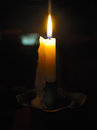 Reading by Candle Light in modern times Royalty Free Stock Photo
