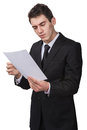 Reading a document young business man Royalty Free Stock Images
