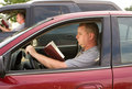 Reading and Driving Royalty Free Stock Photo