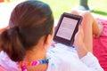 Reading On E-book On Summer Ho...