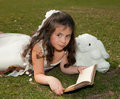 Reading girl on grass Stock Photography