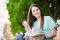 Reading girl with ice cream Royalty Free Stock Images