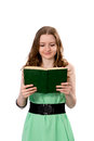 Reading girl young reads a green book Royalty Free Stock Image