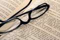 Reading glasses on book Royalty Free Stock Images
