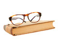 Reading glasses on a book Royalty Free Stock Photo