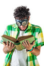 Reading goggles a guy wearing casual clothes and on old pair of over a white bachground and an old book Royalty Free Stock Photography