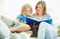 Reading at home portrait of cute girl and her mother a book Royalty Free Stock Images
