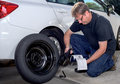 Reading instruction on replacing a spare tire Royalty Free Stock Photo