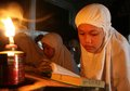Reading koran using torch muslims quran as the source of the light in solo central java indonesia Royalty Free Stock Photo