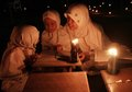 Reading koran using torch muslims quran as the source of the light in solo central java indonesia Stock Photos