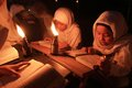 Reading koran using torch muslims quran as the source of the light in solo central java indonesia Royalty Free Stock Image