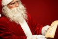 Reading letter portrait of santa claus looking at christmas in his hands Royalty Free Stock Photos